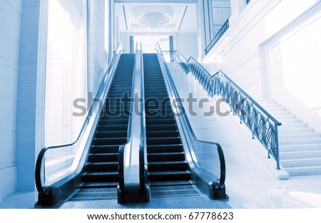 Escalator hall, very modern buildings.