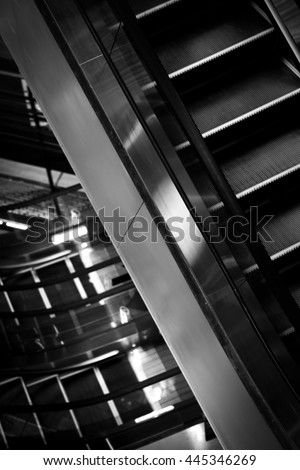 escalator in building. black and white