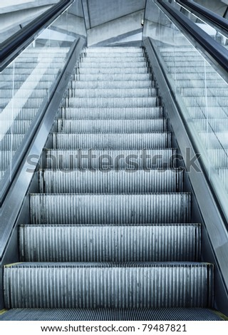 escalator in France airport with terminal panel