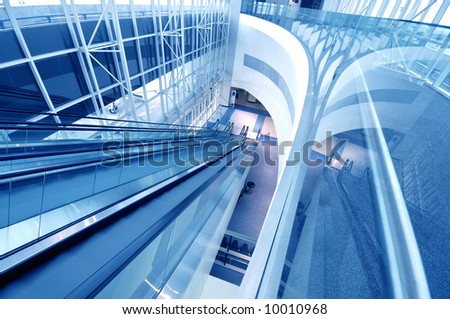 Escalator in modern building - stock photo