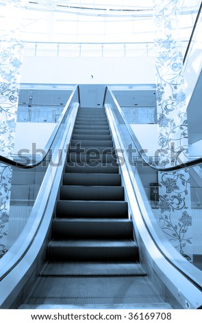Escalator in modern building in blue