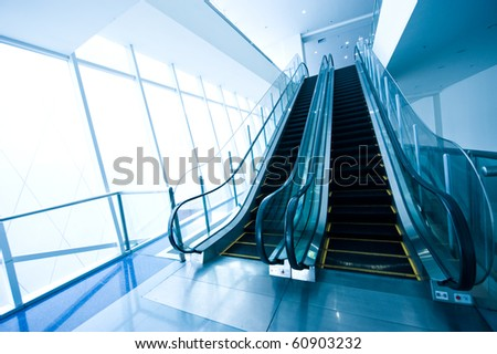 Escalator in modern office building.