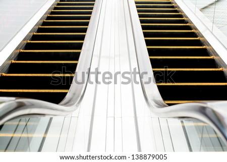 Escalator in shopping mall - stock photo