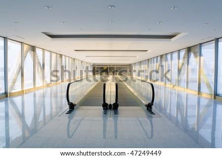 Escalator in some modern building. - stock photo