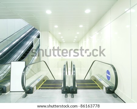 Escalator in underground passage - stock photo
