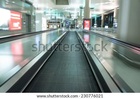 escalator ,interior of airport - stock photo