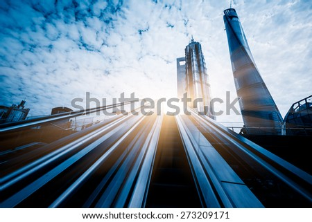 escalator of modern office building, blue toned images. - stock photo