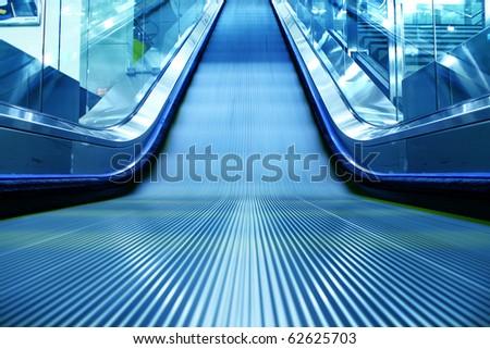 escalator of the subway station in hongkong china. - stock photo