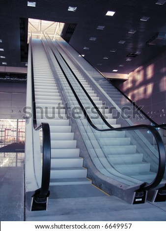 escalator one flight to the next level - stock photo