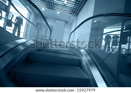 escalator stairs in blue tone - stock photo