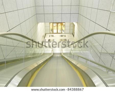 Escalator to underground - stock photo