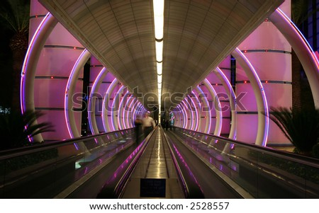 Escalator with colorful lights - stock photo