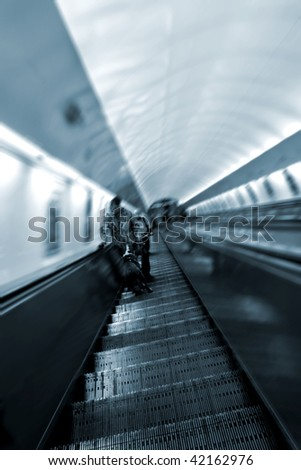 escalator with people in Prague underground - blurred foregrounding movement - stock photo