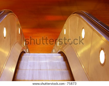 """Escalators going """"down to hell"""" - stock photo"""