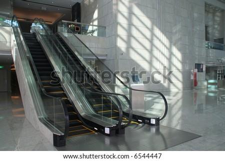 Escalators in corporate building - stock photo