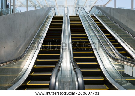 Escalators in modern concourse - stock photo