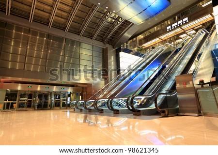 escalators in the modern lobby at night - stock photo