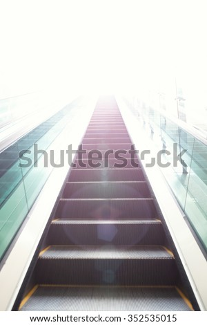 Escalators stairway as a concept of successful elevation - stock photo