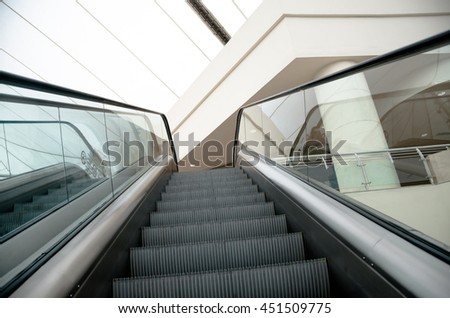 Escalators stairway inside modern mall going up - stock photo