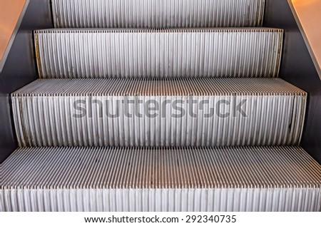 escalators stairway inside modern office building. - stock photo