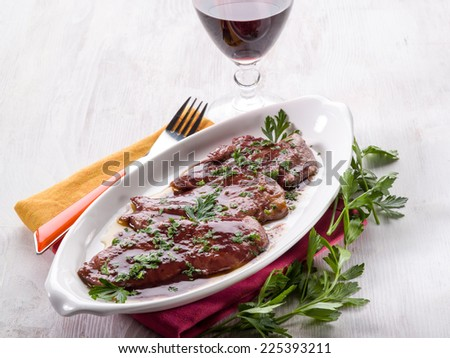 escalope cooked with red wine - stock photo