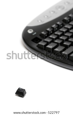 escape key escaping - shot over white with focus on fleeing key - stock photo