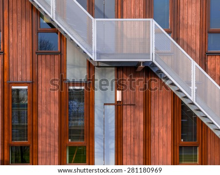 Escape stairs on a sustainable wooden office building background - stock photo