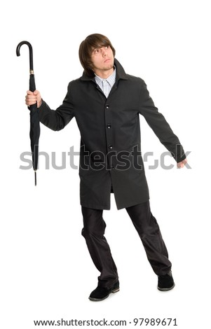 Escaping a young man in a raincoat looking up. - stock photo