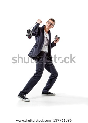 Escaping paparazzi photographer with old-fashioned cameras and QR-code on t-shirt - stock photo