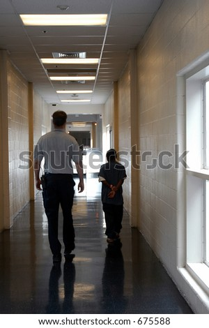Escort of juvenile offender - stock photo