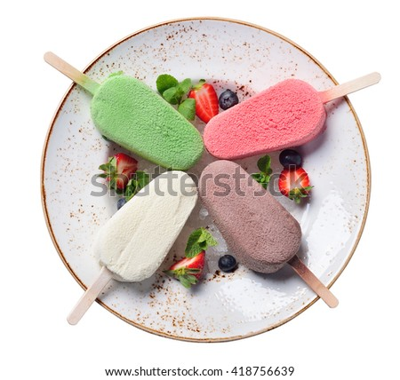 Eskimo ice cream on a plate, four color and flavor, berries and ice. Isolated - stock photo