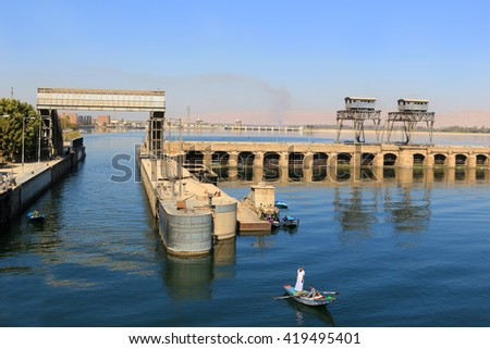 ESNA, EGYPT - FEBRUARY 3, 2016: Approaching the Ship locks in Esna, and old dam on the Nile River, Egypt - stock photo