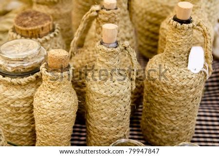 esparto handcrafts covering glass bottles Mediterranean Balearic Islands - stock photo