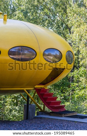 ESPOO, FINLAND-August 02: The first mass-produced Futuro house. The Futuro is a house designed by Matti Suuronen. August 02, 2013 in Espoo, Finland