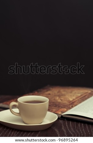 Espresso and art book - stock photo