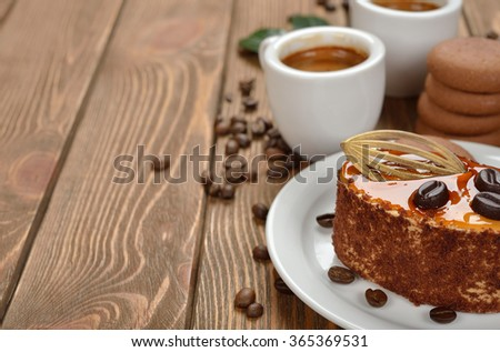 Espresso and cake on a brown background - stock photo
