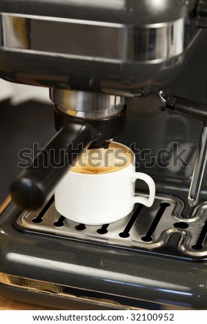Espresso and Cappuccino coffee maker in action - stock photo