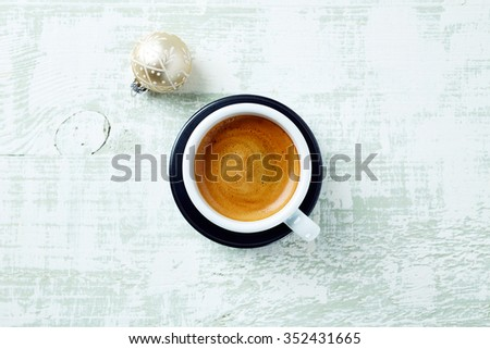 Espresso and Christmas ball on a wooden background - stock photo