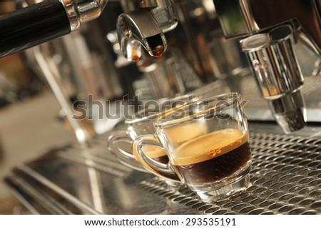 Espresso being prepared from coffee machine - stock photo