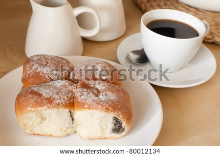 Espresso Coffee and Traditional Homemade Stuffed Cakes Filled With Damsoncheese on the Table - stock photo