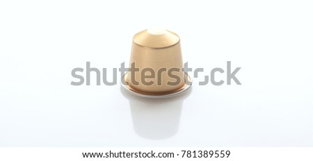 Espresso coffee capsule isolated on white background, Closeup view with details