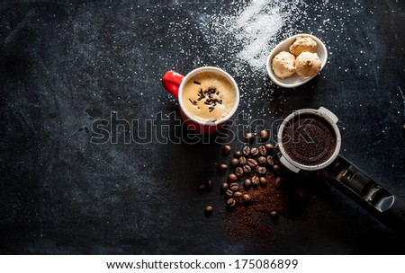 Espresso coffee, cookies and sugar on black cafe table from above. Background with free text space. - stock photo