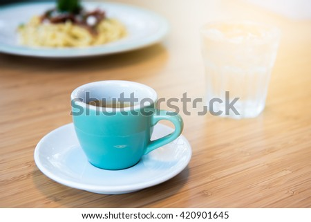Espresso coffee cup. fresh morning coffee on the wooden table. - stock photo