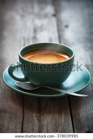 Espresso coffee in a green cup,selective focus