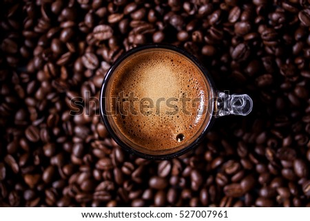 espresso coffee on a coffee beans background