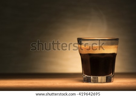 Espresso coffee on a wooden table - stock photo