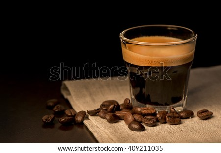 Espresso coffee with beans - stock photo
