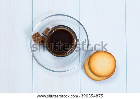 Espresso cup of black coffee with sugar and cookies on a wood table - stock photo