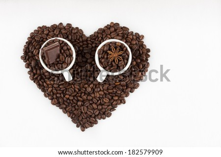 espresso cups filled with coffee beans - stock photo