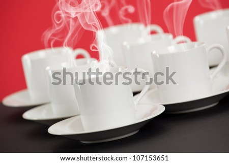 Espresso cups with steaming hot coffee - stock photo